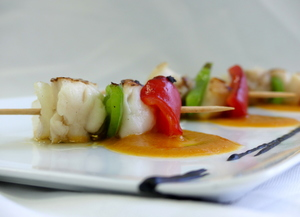 Monkfish and scallop skewer with seafood sauce