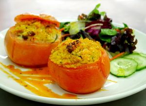 Bulgur, sultanas, red pesto stuffed tomatoes with salad