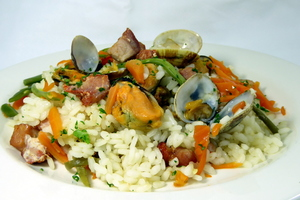 Rice and marinated pork loin, clams and mussels