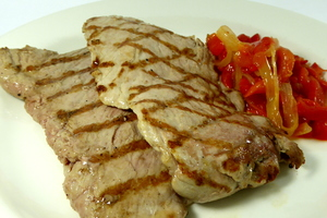 Grilled pork tenderloin with red peppers and onions stew