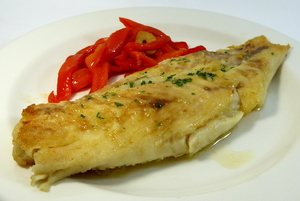 Grilled perch with red peppers stew
