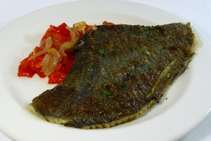 Grilled turbot with red peppers and onions stew
