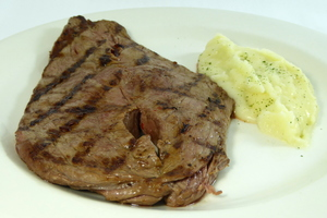 Grilled veal steak with mashed potatoes