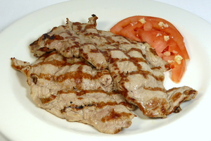 Grilled pork tenderloin with tomato and garlic salad