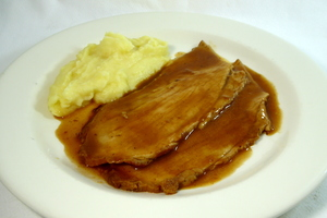 Roasted pork ham with Oporto gravy and mashed potatoes