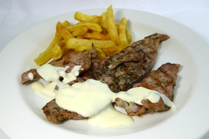 Grilled turkey chop with baked potatoes and cheese sauce
