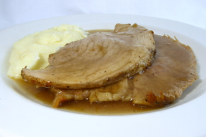Roasted pork ham with mustard gravy and mashed potatoes