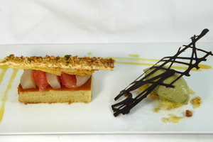 Grapefruit and pear financier sponge cake with dried fruit puff-pastry and pistachio ice cream