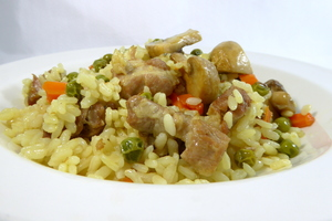 Dry rice with pork meat and champignon mushrooms