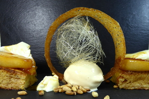 Brioche garnished with caramelized pears and apples, dried fruits, curd and honey-ice cream