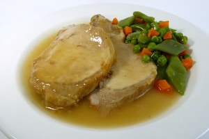 Roasted rack of pork with diced vegetables