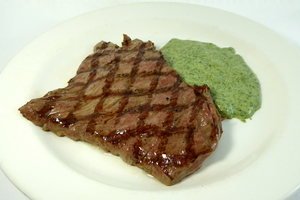 Grilled veal steak with muslin spinach