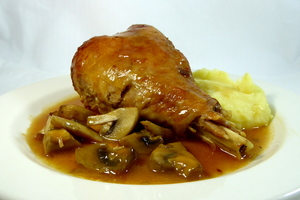 Braised turkey thighs with champignons and mashed potatoes