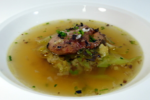 Consommé with a garnish of roasted foie gras and cabbage