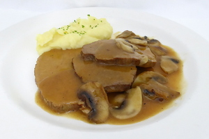 Braised eye round with champignons stew and mashed potatoes