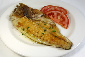 Grilled gilt-head bream with tomato and garlic salad