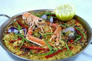 Paella with langoustines, clams, rabbit and squids