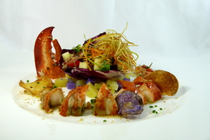 Lobster and potato salad with dried fruits and nuts vinaigrette