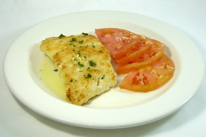 Grilled cod with tomato and garlic salad
