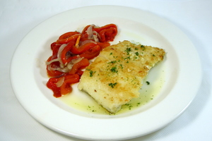 Grilled cod with red peppers and onion stew