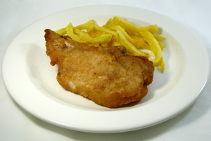 Breaded pan fried pork chop with potatoes