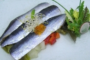 Sardines marinated with ginger and Escalibada (grilled vegetables salad)