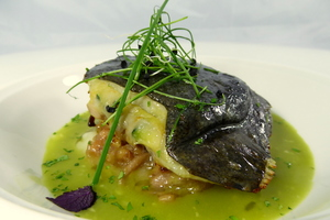 Turbot filled with vegetables and accompanied with clam sauce