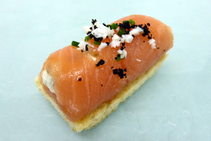 Salmon roll on a bread toast
