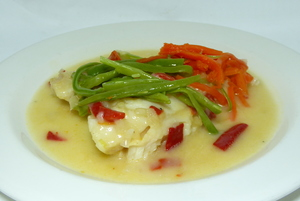 Hake au court-bouillon with mixed vegetables in julienne