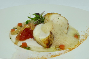 Roasted monkfish with tomato marmalade and germinated vegetables salad