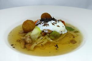 Poached and truffled eggs in homemaid pasta with foie gras croquettes