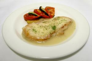 Roasted chicken breast in brown garlic sauce