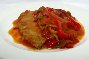 Simmered and buttered veal with piperrada (green and red pepper stew)