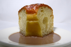 Savarin sponge cake soaked in syrup and rum
