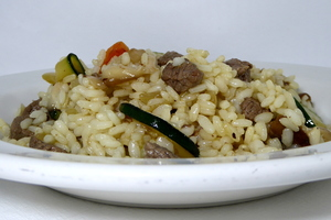 Sauteed rice with veal meat and vegetables