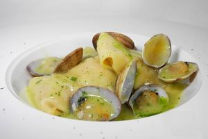Monkfish raviolies in clam sauce