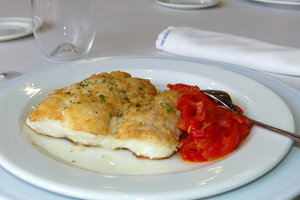 Grilled hake with red peppers stew