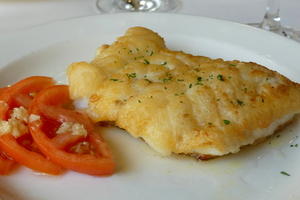 Grilled whiting with tomato and garlic salad