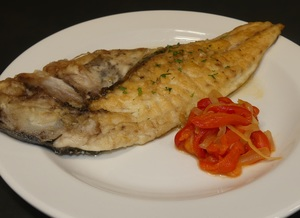 Grilled gilt-head bream with red peppers and onions stew
