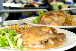 Roasted chicken with French fries and salad