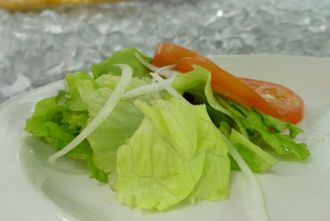 Lettuce, tomato and green onion salad