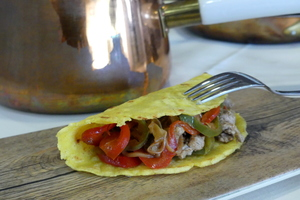 "Roasted pork ""Mexican tacos"" with onion and peppers"