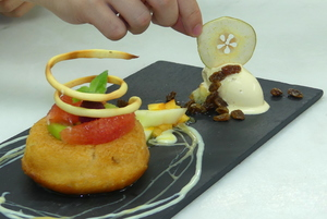 Rum-soaked savarin spongecake with raisin ice cream