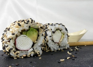 King crab, avocado and cucumber uramaki sushi