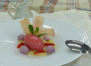 Rhubarb garnished with strawberry-rhubarb ice cream, glazed rhubarb and caramel