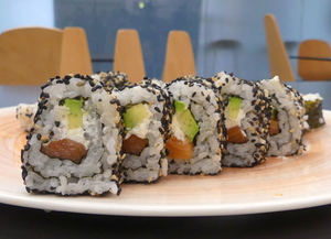 Uramaki sushi with salmon, avocado and cheese