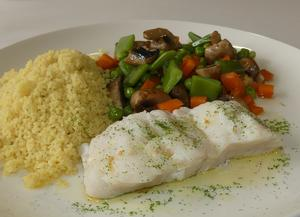 Steamed hake with couscous and vegetables