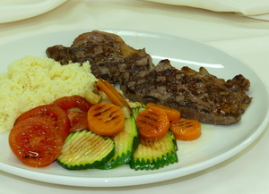Grilled veal loin with couscous and grilled vegetables