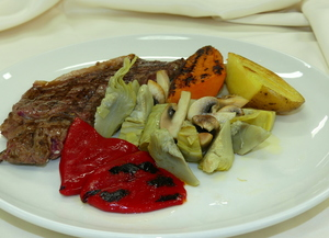 Grilled rib eye with artichokes, mushrooms, peppers, baked potato and sweet potato
