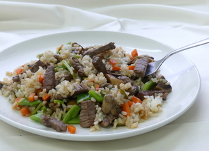 Sauteed rice with vegetables and meat